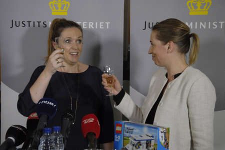 ministers: COPENHAGENDENMARK_ Ms. Karen Haekkerup (in dark dress)left in pictures resigned as minister for justice and hadnover post to other social democrat ms.Mette Frederiksen is new minister for Justice ,Mette is former minister for labour , Karen gave gits to