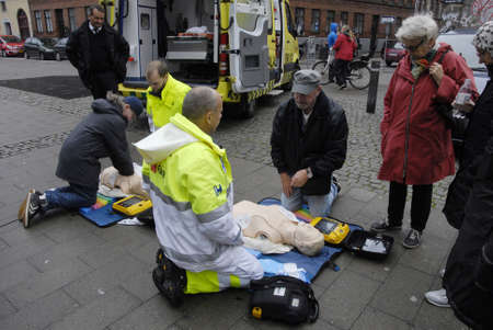 paramedical: COPENHAGENDENMARK_  Danish paramedical team demonstrating first aids how to start heart today to danish public today on interntional heart start day celebration          16 October  2014