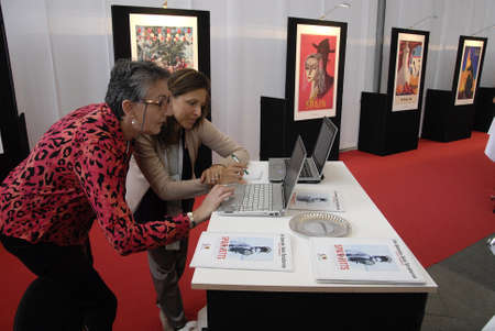 spainish: COPENHAGENDENMARK_ Fortuna I.Lehnsdal in red  and black dress and short hair cut Press and PR and Ms.Maria Diaz Gonzalez as Promation and travel trade at Spainish travel stand where travel  agency celebrate 50 years jubilee this 2014          18 October