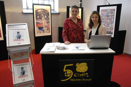 COPENHAGENDENMARK_ Fortuna I.Lehnsdal in red  and black dress and short hair cut Press and PR and Ms.Maria Diaz Gonzalez as Promation and travel trade at Spainish travel stand where travel  agency celebrate 50 years jubilee this 2014          18 October