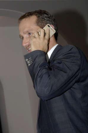 htc: COPENHAGENDENMARK Kristian Jensen parliament member for liberal danish party and former minister talking on smartphone           23 October  2014