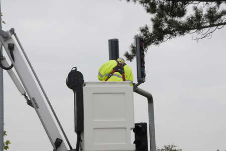 trafic: COPENHAGENDENMARK_Electric workers woking on electric pole on trafic lights            24 October  2014