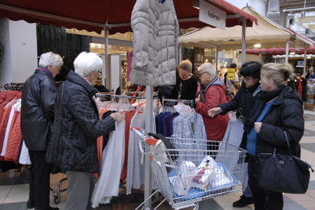 eldlery: COPENHAGENDENMARK_  Shoppers inspecting retail cloth at shop          24 October  2014