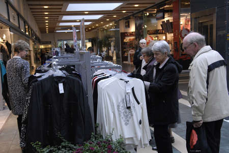 COPENHAGENDENMARK_  Shoppers inspecting retail cloth at shop          24 October  2014