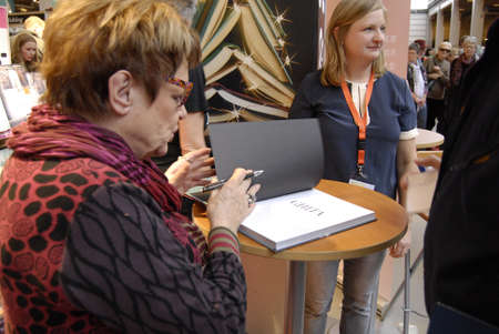 serie: COPENHAGENDENMARK_ Ms.Ghita Norby (Ghita N�rby)danish actress signs her biography book book is writen by jouralist Ms.Lea Korsgaard ,Ghita played leading role in danish tv serie Matador which been shw world around at bogforum dansh book fair or book fest