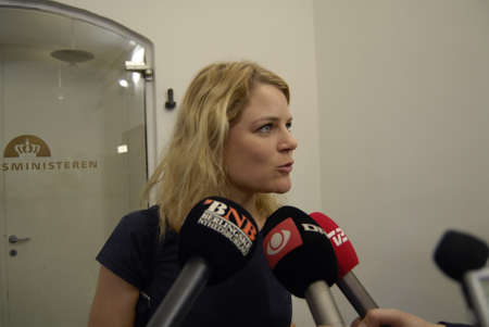 press media: COPENHAGENDENMARK_  Ms.Johanne Schmidt Nielsen and compnay enhedsliten talking to press media beforein going into meeting with finance minister Bjane CCorydon abut danish annual state budget finanslov 2015           10 November  2014 Editorial