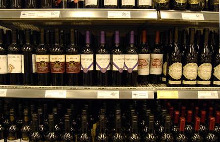fakta: COPENHAGENDENMARK_Red wine bottles on shelv at food super market            19 November  2014