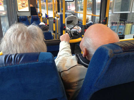 eldlery: COPENHAGENDENMARK_Danish senior couple travel with danish pensionest or retired people public transport ticket  couple enjoy talking to during their journey             19 November  2014