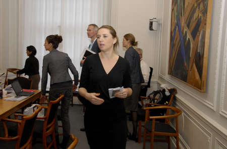press media: COPENHAGENDENMARK_ Danish minister for Law and Order or justice minister Ms.Mette Frederiksen talkin to parliament members of danish people party in meeting room and press media before going into meet with Political sylum sekkers comomittee danish parlia