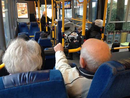 COPENHAGENDENMARK_Danish senior couple travel with danish pensionest or retired people public transport ticket  couple enjoy talking to during their journey             19 November  2014