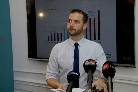 Copenhagen, Denmark . Morten Ostergaard ( Morten Ostergaard)vice prime minister  and minister for Ecocomy and hme holds press conference and high light danish growth in economy  today at ministry for economy           11 December   2014