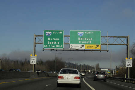 Seattle. Washington state. USA   Driver using map quest at iphone to find route in sSeattle havey trafic             14 December   2014.