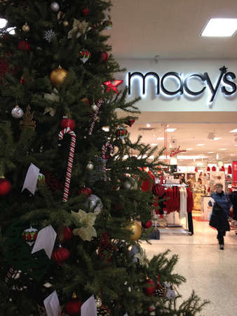 Lewiston . Idaho state. USA _Macys decorated christmas tree with various christmas decoration items display for for christmas sale at Lewistn central mall                16 December   2014.