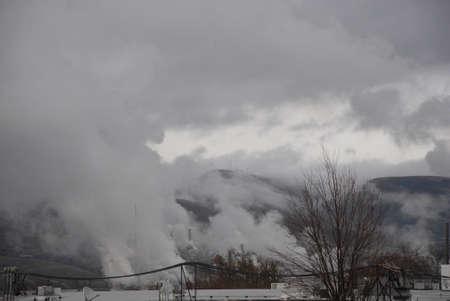 idaho state: Lewiston . Idaho state. USA   Smoke and rain over Lewistin hills             19 December   2014.