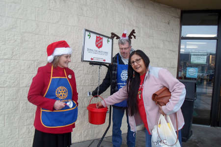 Lewiston . Idaho state. USA   Female givingchristmas donation to salvation army valanteers so slavatio army give futher to unfortunate families to elebrate christmas               20 December   2014.