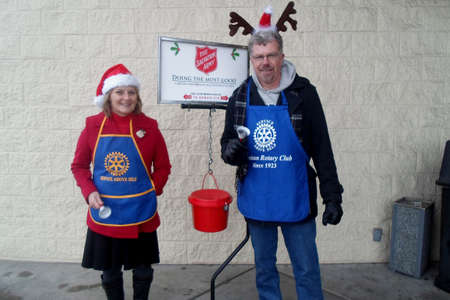 unfortunate: Lewiston . Idaho state. USA  Female givingchristmas donation to salvation army valanteers so slavatio army give futher to unfortunate families to elebrate christmas               20 December   2014.
