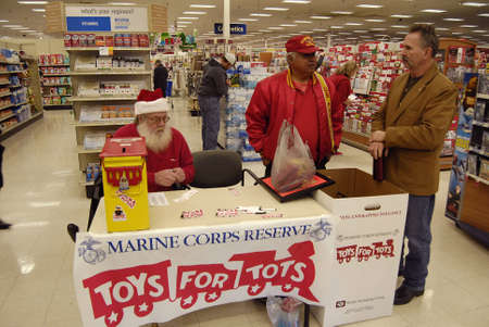 tots: Lewiston . Idaho state. USA _USA Retired Marine Corps Reserve collect Toys for tots during christms and donate to children those may not have toys for christmas presents                21 December   2014.