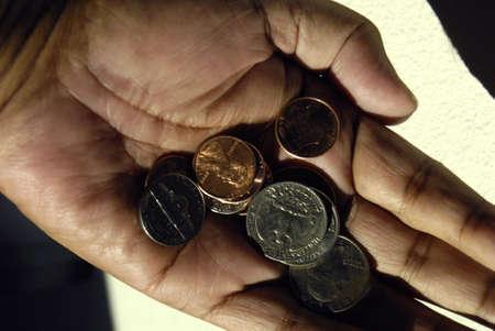idaho state: Lewiston . Idaho state. USA  USA coins on hand palm              22 December   2014.