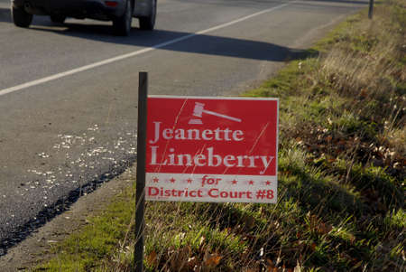 pierce: Burkley. Washington state. USA_Playcards on road side drive of  Jeanette Loneberry for District coourt distcri 8th GPO and Jason Ritchie for congress 8th districk D for elections from pierce county                29 December   2014. Editorial