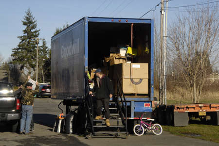 goodwill: Burkley. Washington state. USA  _On new years day  males delivering thier chrisrmas stuff as charity to Goodwill station to Tocoma Goodwill station in piece county       01 January   2015 Editorial