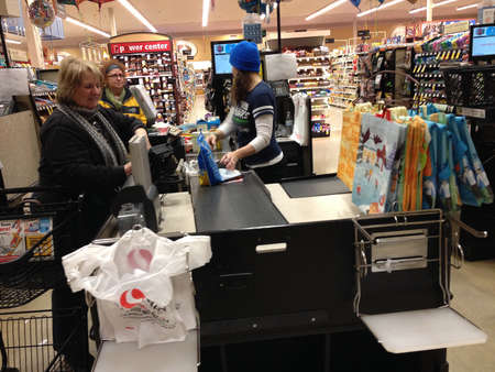 food state: Bonney Lake. Washington state. USA  _Food shoppers shopping in safeway grocery store today on             02 January 2015