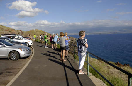 holiday maker: Maui .Hawaii islands ,USA_Tourists mostly from USA mainland at senic site and with boats to whale watching at Maui island coast today on          21 January 2015