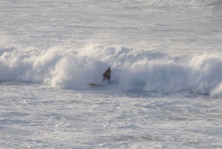tides: Maui .Hawaii islands ,USA   _Female tourists watching sunset high tides and fursboarding at Maui coast on       23 January 2015 Editorial