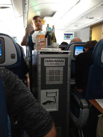 wine stocks: Maui .Hawaii islands ,USA  _Life on Hawaiian airlines flight from Maui island via Honolulu internternational airport and from hoholulu to mainland seattle washington state usa on        25 January 2015