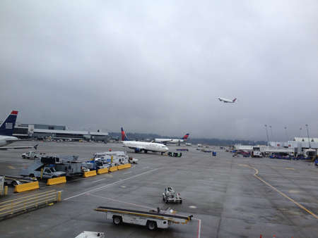 eonomy: Seattle airport. Washington state .usa   USA delta flight at seattle interntional airport seat-com               28 January 2015