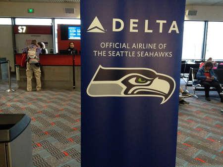 seahawks: Deltadesh en Seattle mensaje de negocios del aeropuerto internacional de Delta Airlines oficiales de los Seattle Seahawks