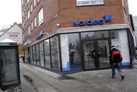febuary: Copenhagen-Denamrk _Man walks toward nordea bank for cashing money from nordea bank                 04 Febuary 2015