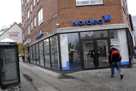 cashing: Copenhagen-Denamrk _Man walks toward nordea bank for cashing money from nordea bank                 04 Febuary 2015