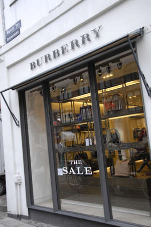 febuary: Copenhagen-Denamrk_consumer pass by the sals sign at window at Burberry store                   04 Febuary 2015
