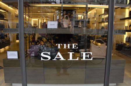 Copenhagen-Denamrk_consumer pass by the sals sign at window at Burberry store                   04 Febuary 2015