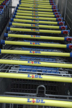 Kastrup_Denmark  German food chain Lidl opens from early monring 8 am till 22 or 10 pm night  and shopping carts are park in carts parking place            12 Febuary 2015