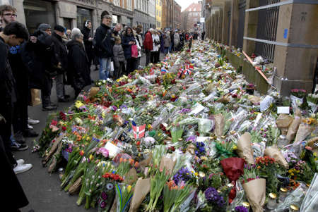 synagogue: Copenhagen-Denamrk _Danish police present at Jews Synagogue on fouth day terror attacked on Jews synagogue where Dan Uzan was shot and killed this last weekend  people come with flowers at victim site                18 Febuary 2015 Editorial