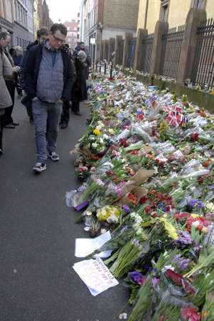 attacked: Copenhagen-Denamrk _Danish police present at Jews Synagogue on fouth day terror attacked on Jews synagogue where Dan Uzan was shot and killed this last weekend  people come with flowers at victim site                18 Febuary 2015 Editorial