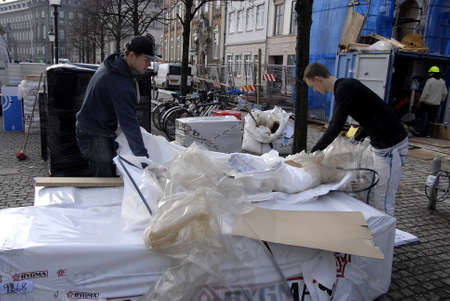 inquiring: Copenhagen-Denamrk ,  24 Febuary 2015  _Two males in dark jcaket inquiring why there much mess at constructions site at hojbroplad today Editorial