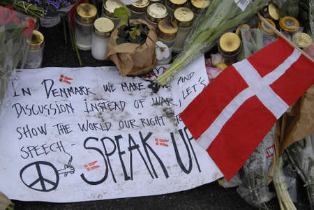 attacked: COPENHAGENDENMARK.  24 February 2015-Memorial of late Finn Norgaard who was died in terrorest attacked Krudttonder culture cafe  on osterbro on sunday night during debate meeting with swedish cartoonest here are various message with flowers including Dan Editorial