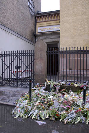 synagoge: Copenhagen-Denamrk ,  24 Febuary 2015   _Danish police stand guard at jews synagogue on 10thday at Dan Uzan memoriol at Jew Synagogue at krystalgade  jews community has hash critic over police security for jews instirtue like synagoge jews school adn jews