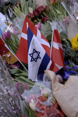 attacked: COPENHAGENDENMARK _25 February 2015-Police presents at Extebded memorial untill next week at Jews synagogue at krystalgade in Copenhagen Jeews grief and sorrow ended  officially on monday night  ,14 feb 2015 aynagigue was terrrorest attacked and jew man