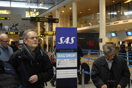 thier: Kastrup.Copenhagen.Denamrk _01 March 2015, SAS Scandinavian airlines air attendances on strike now SAS and trade union will settle dispute in court due to report Japanese passengers waiting in line to rebook thier flight to Japan vi china passenger showin Editorial