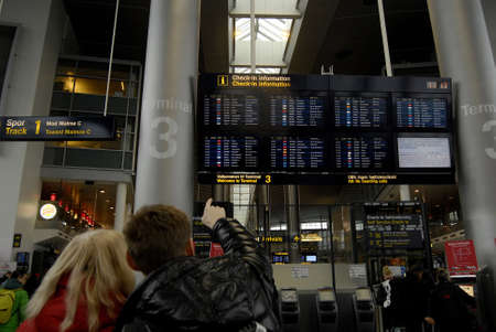 Kastrup.Copenhagen.Denamrk _01 March 2015, SAS SAS Flight cancelled and delay and Scandinavian airlines air attendances on strike now SAS and trade union will settle dispute in court due to report Japanese passengers waiting in line to rebook thier flight