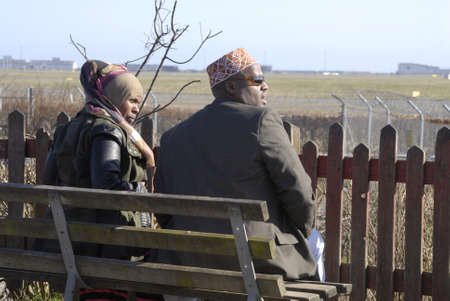 somalian: Kastrup.Copenhagen.Denamrk    _Somalian couple watching flights and sepcial waiting at kastrup airport               09 March 2015