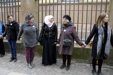 jews: COPENHAGENDENMARK. 14 March 2015   _On the muslim living in Copenhagen institative handfull muslims and jews joined by danes arranged people holding hands chain around the jews synagogue in the aftermath terrorest attacken on synagodu on 15 Feb 2015 sund