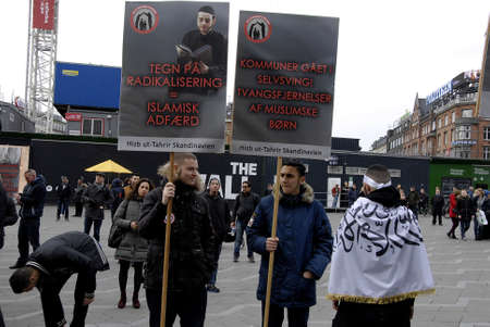 ut: COPENHAGENDENMARK. 14 March 2015   _Hizb Ut Tahirir  protest danish danish laws and slogan aginat danish social minister  Menu  Sareen  they called him oh poster emny of Allahn protest was staged at Copenhagen Town Hall today on sunday