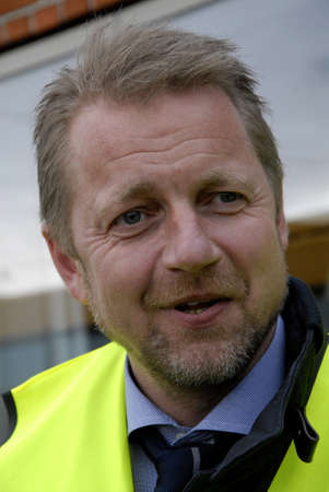 liberal: .Copenhagen.Denamrk  _Martin Geersten member of parliament and spokeman for integration for danish liberal (venstre)party visits Arriva bus terminal with his party chairman Lars Lokke Rasmussen today                26 March 2015 Editorial
