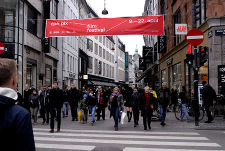shoppingbags: COPENHAGENDENMARK. 27 March 2015 _Life on pedestrain street shoppers and various stores on pedtestrain street today friday