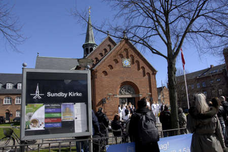 church service: .Copenhagen.Denamrk _04 April 2015_Sundby luther church holds easter saturday yard service for general public  48 prcents are danish state member and church tax payers and Luthern is danish state church  service is arranged by tow paster  Ms.Elle M.Gyllin