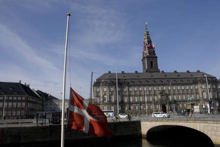 danmark: .Copenhagen.Denamrk _09 April 2015_  Danish flag or danneborg at half mast or half staff at danish parliament bulding christians and all official building and private banks the day to rememer r that today 9th april  Hilter germany occpied denmark 75 years Editorial